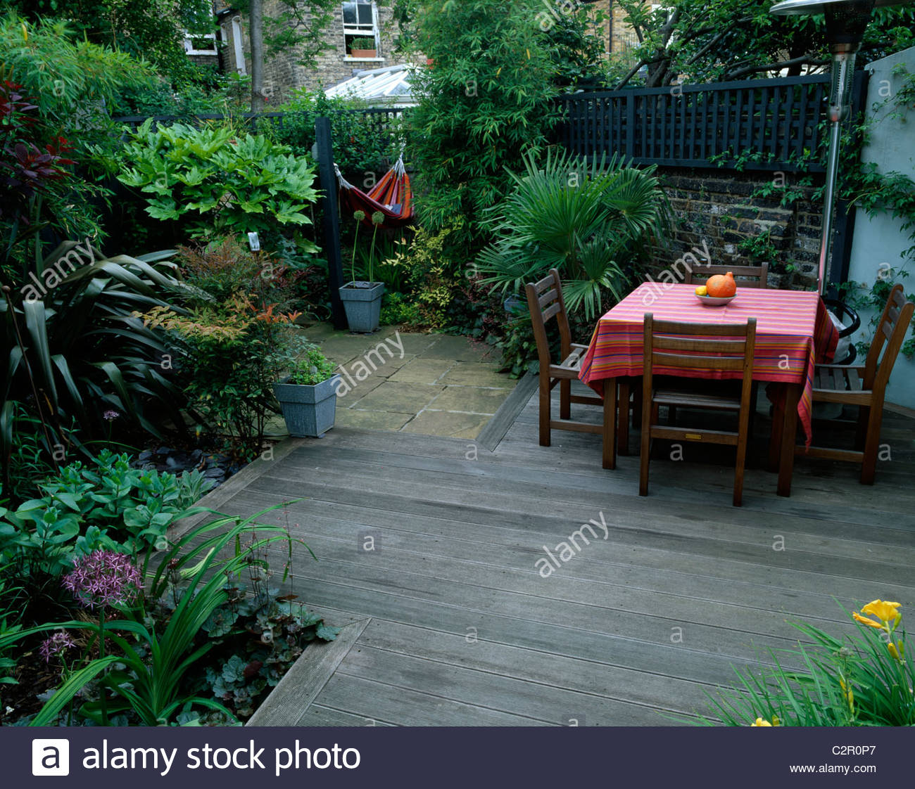 Small Town Garden With Decking, Paving, Table And Chairs, Trachycarpus  Fortunei And Hammock