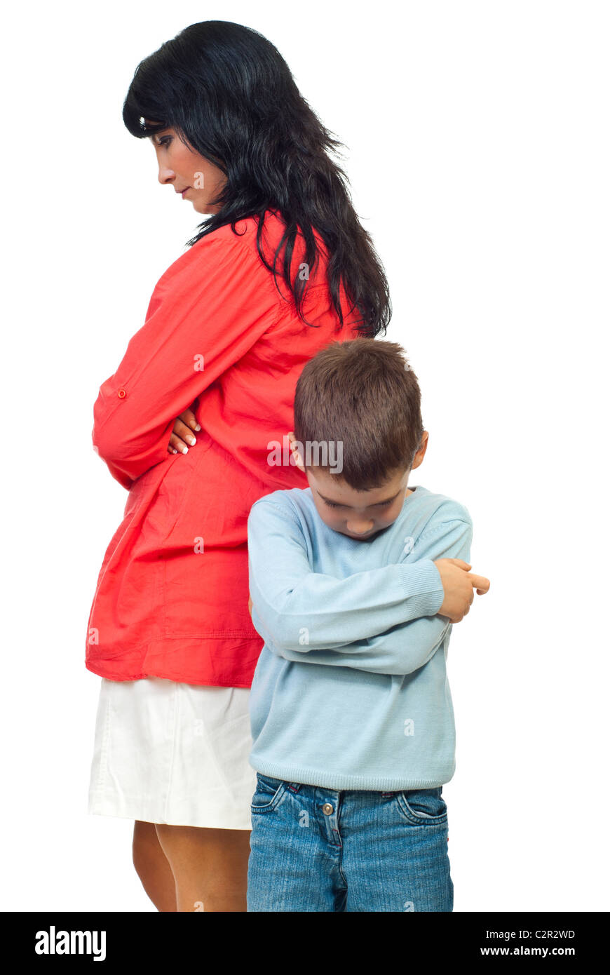 Sad mother and son standing with hands crossed and looking down after conflict isolated on white background Stock Photo