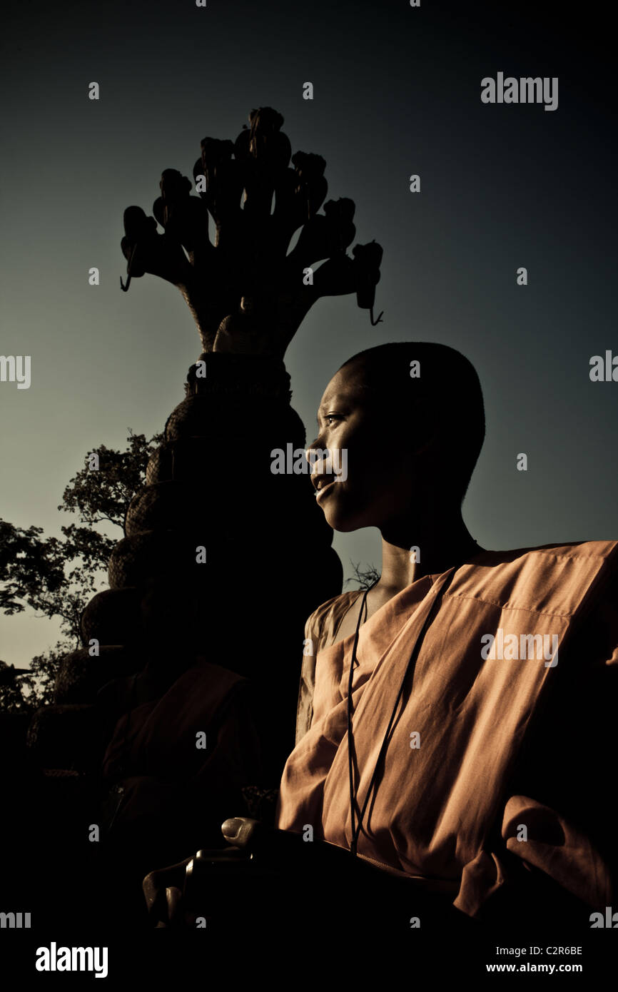 a young monk and a big sculpture in nong kai sculpture park , - Stock Image