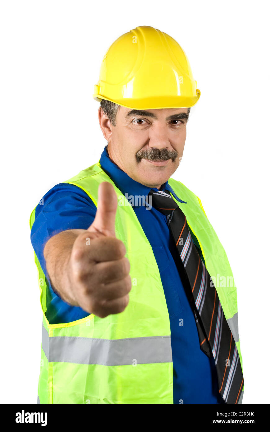 attractive mature engineer man with hard hat giving thumbs -up stock
