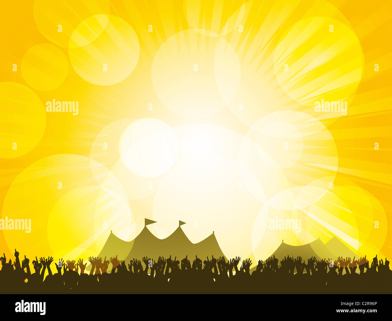 Crowd partying in front of festival tents with a glowing yellow sky - Stock Image