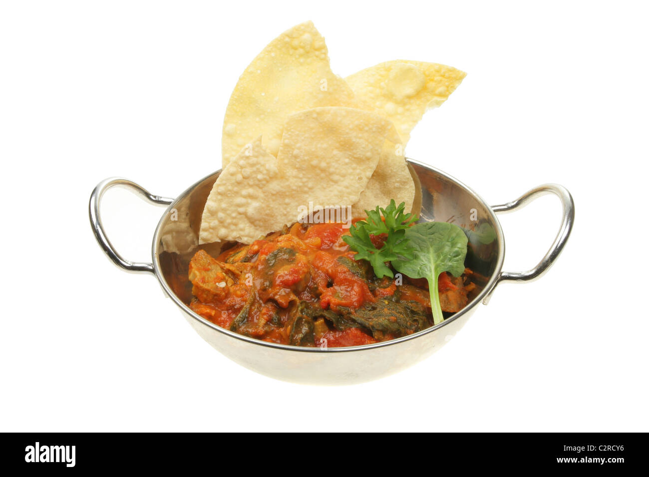 Curry and pappadoms in a balti dish - Stock Image