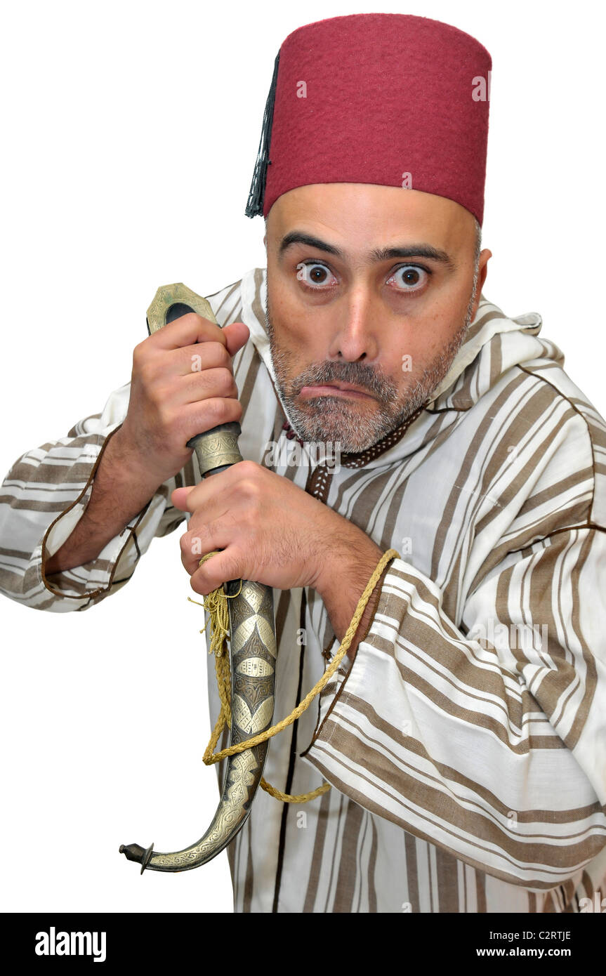 Arabic man with a dagger making funny faces isolated in white - Stock Image