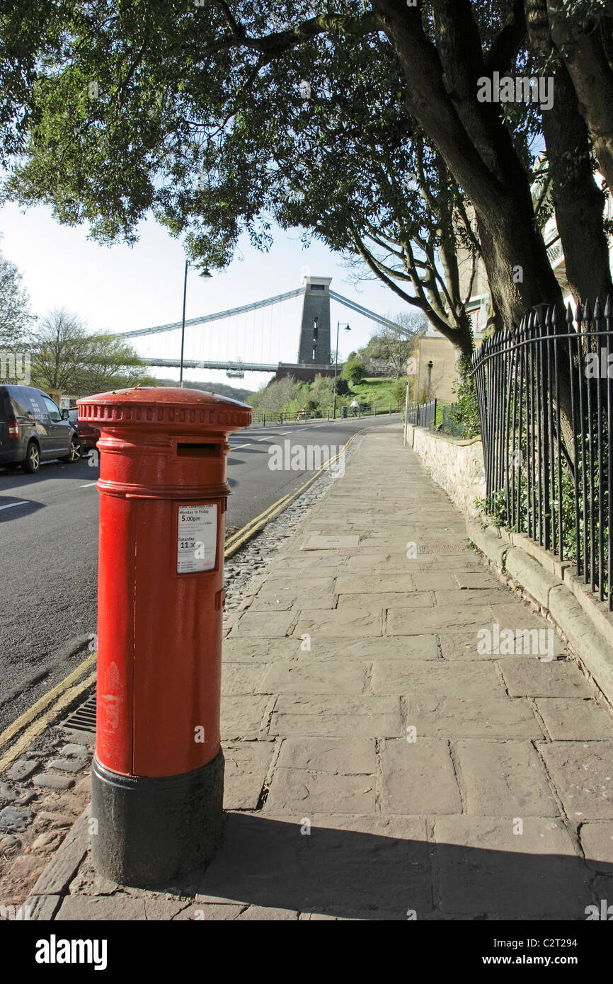 A red post box on Sion Hill in Bristol with the Clifton suspension bridge visible in the background Stock Photo