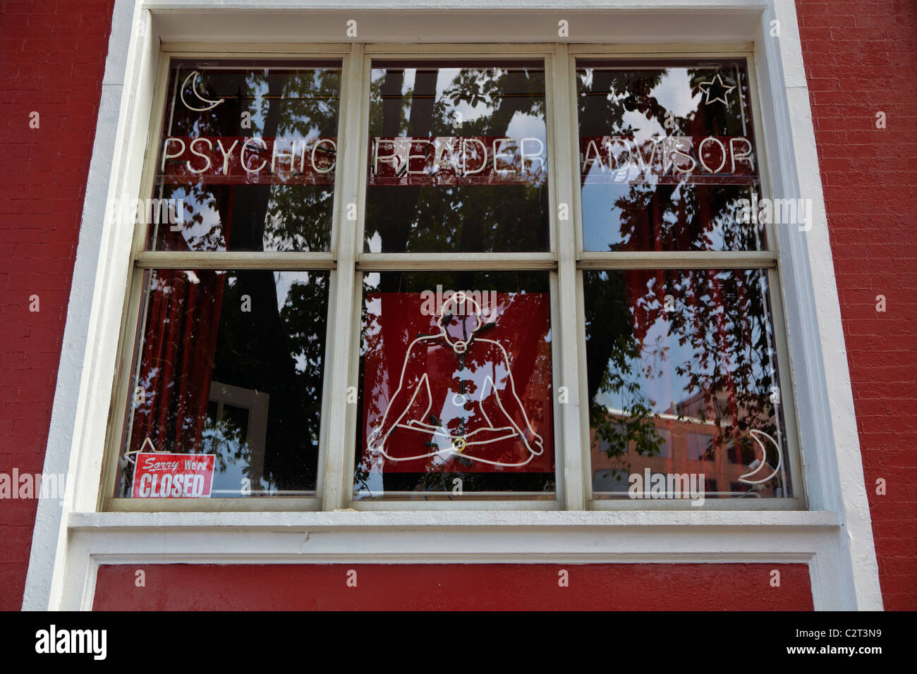 The window of a Psychic Reader Advisor shop in Washington, DC. - Stock Image