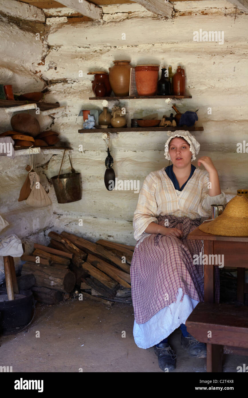 A costumed historical interpreter portraying the Farm Wife at Claude Moore Colonial Farm, McLean, Virginia. Stock Photo