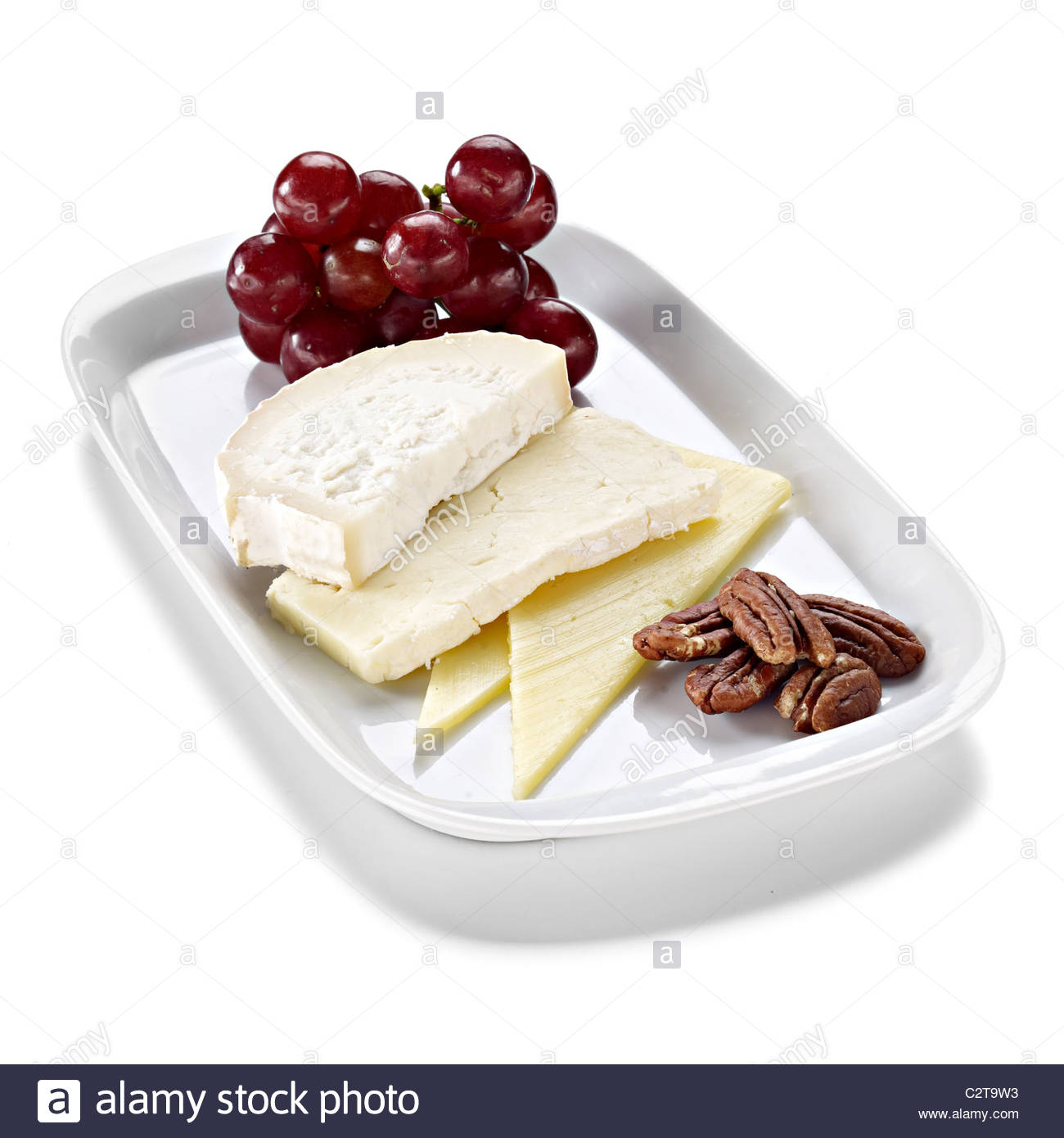 cheese selection grapes pecan nuts - Stock Image