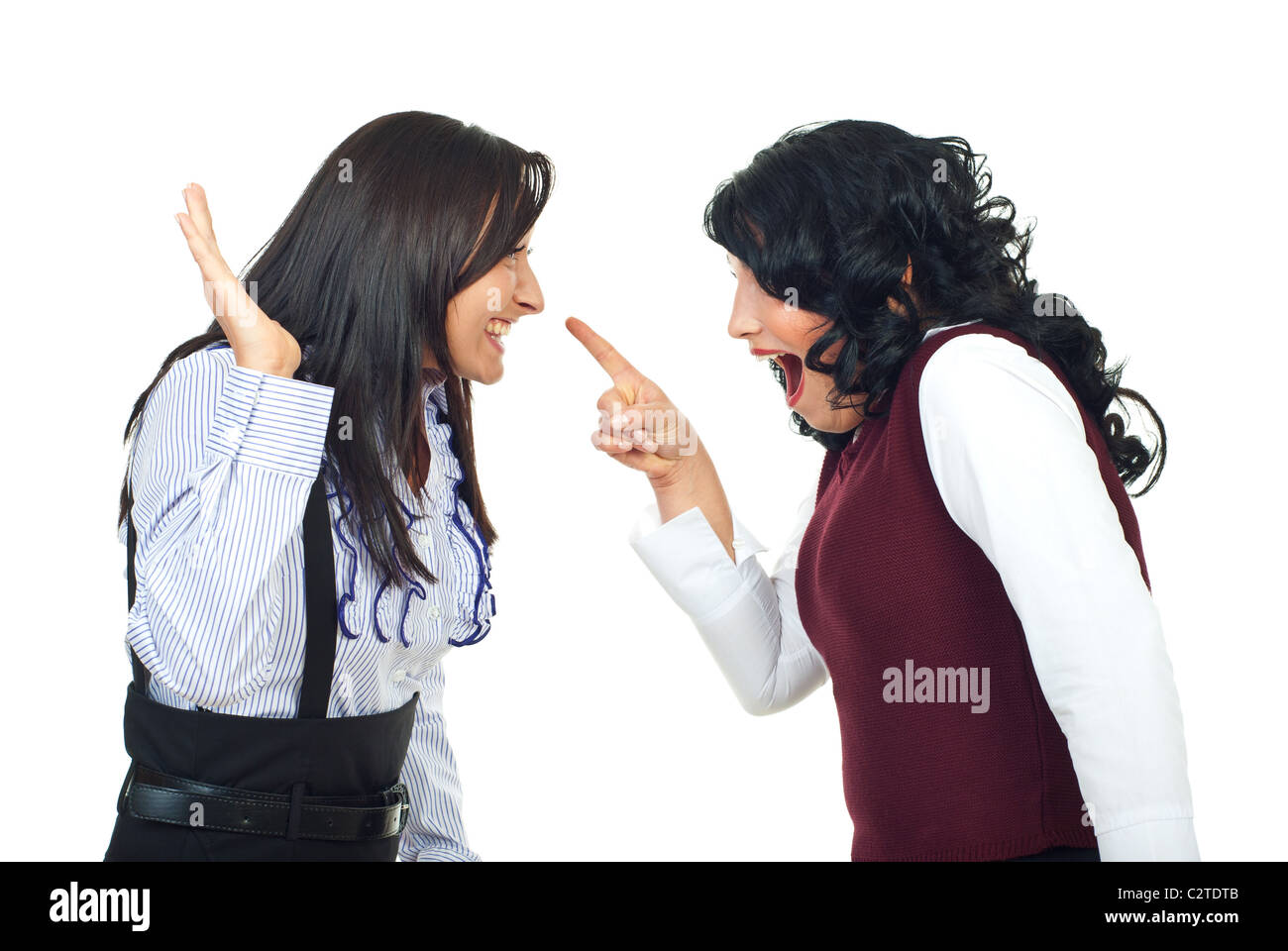 Two women having a funny confrontation and accusatory and laughing together isolated on white background - Stock Image