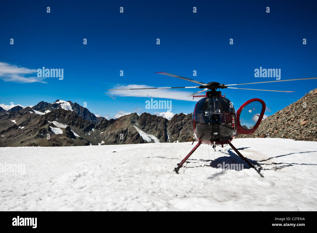 Helicopter on the top of Mount Cook. Southern Alps, West Coast, South Island, New Zealand. - Stock Image