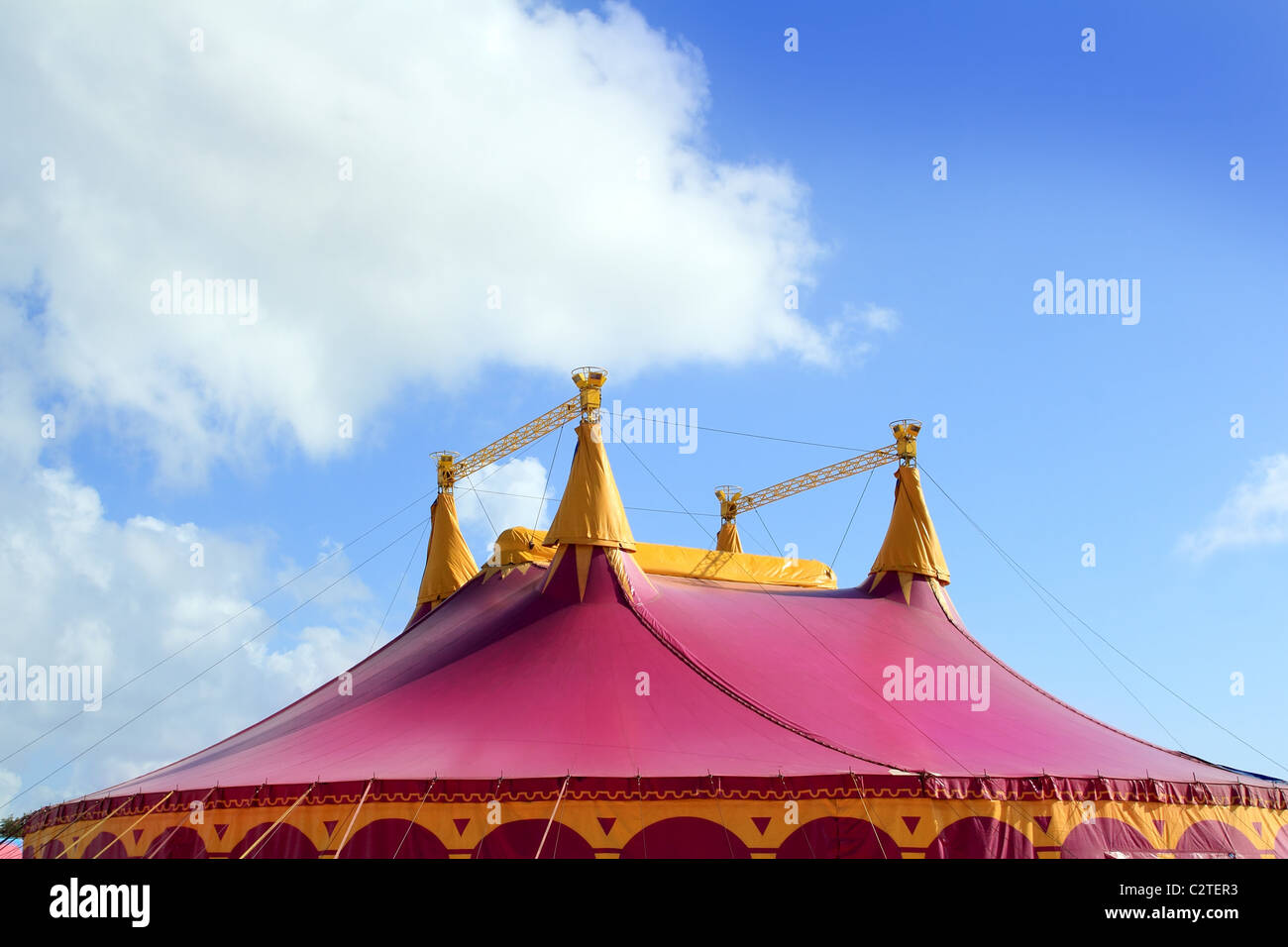 Circus tent red pink color four towers blue sky - Stock Image