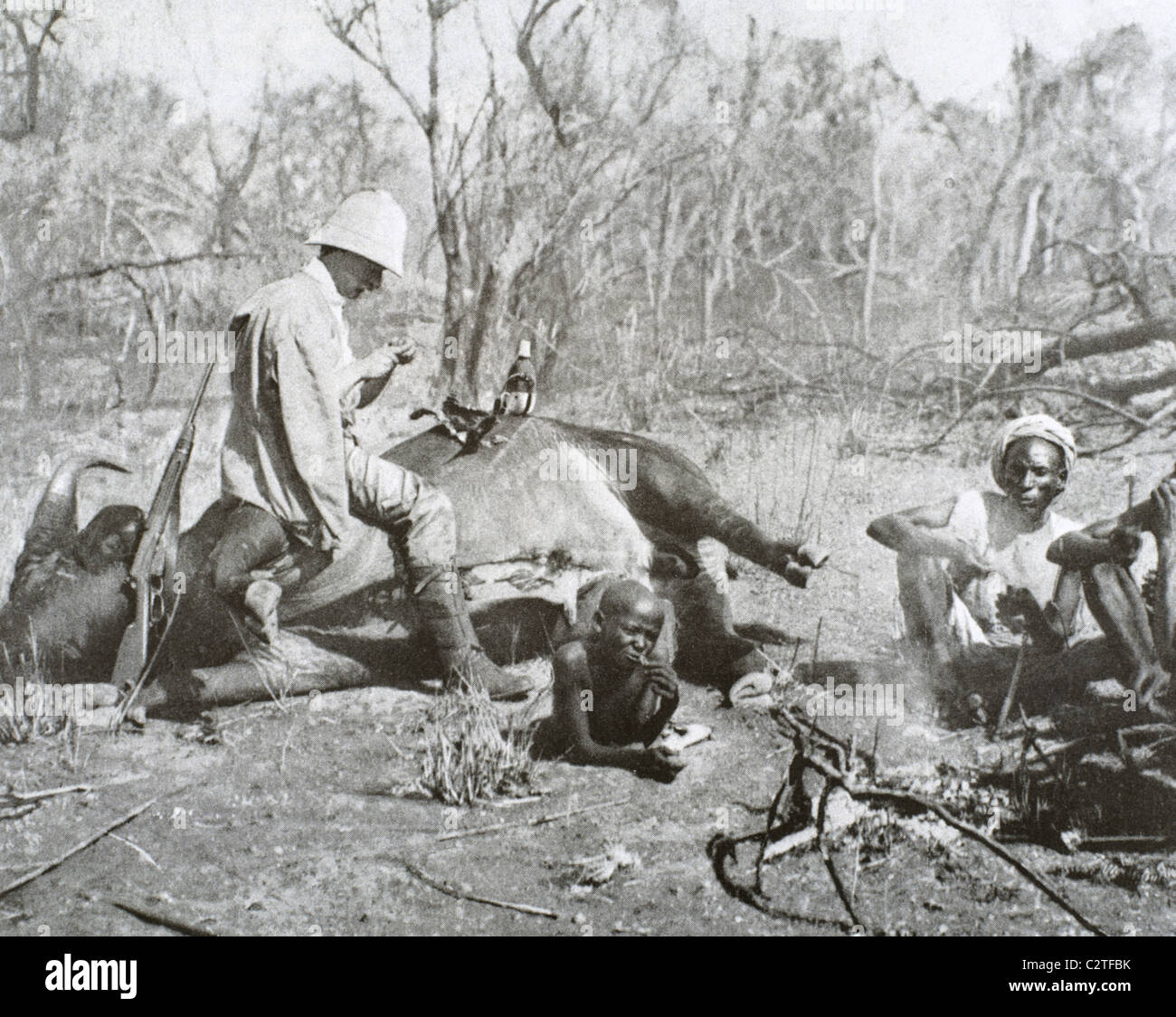 Colonialism. Africa. Eating after the buffalo hunt, 1908. - Stock Image