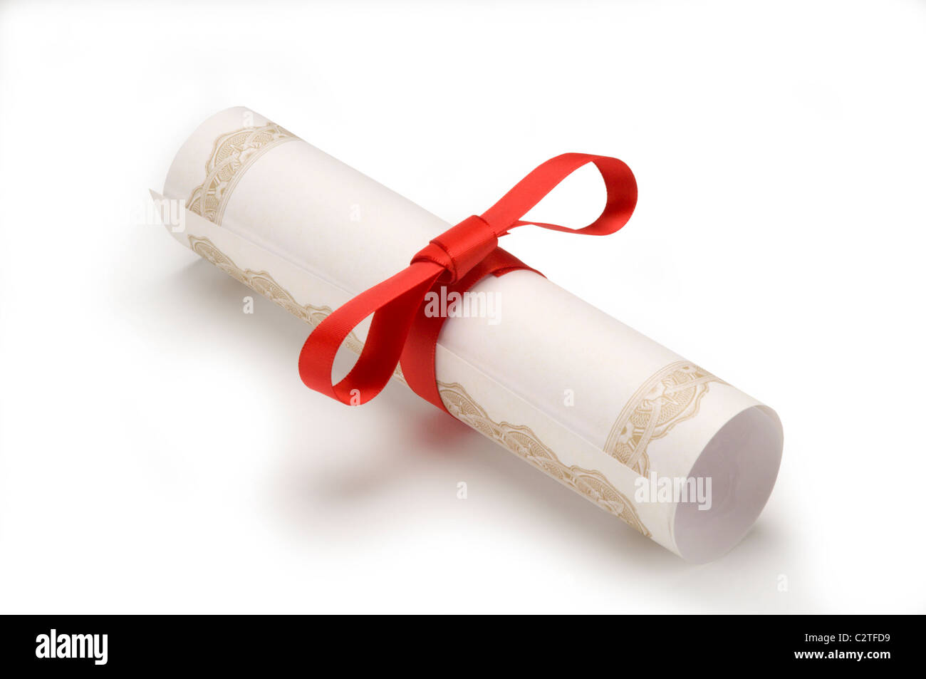 Diploma wrapped in red ribbon on white - Stock Image