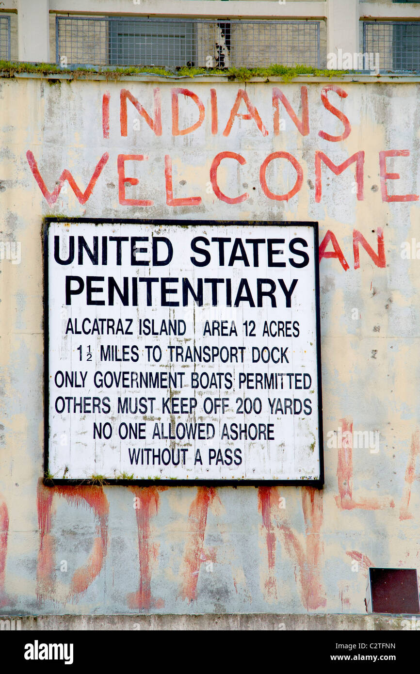 An official sign and a hand painted one commemorating the 1969-1971 Native American occupation of Alcatraz Island. - Stock Image