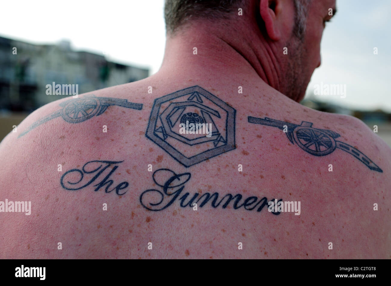 Arsenal Fc Supporter Fan With Tattoo On Arm And Back Stock Photo Alamy