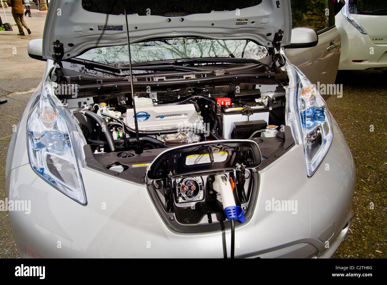 Engine compartment and charging port of the Nissan Leaf, a five-door mid-size hatchback all-electric zero-emissions - Stock Image