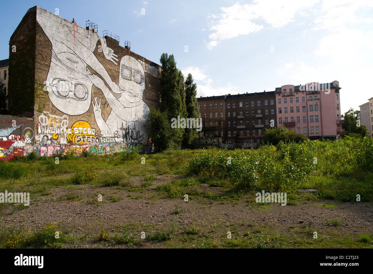 Giant streetart mural by artist Blu in Kreuzberg Berlin - Stock Image