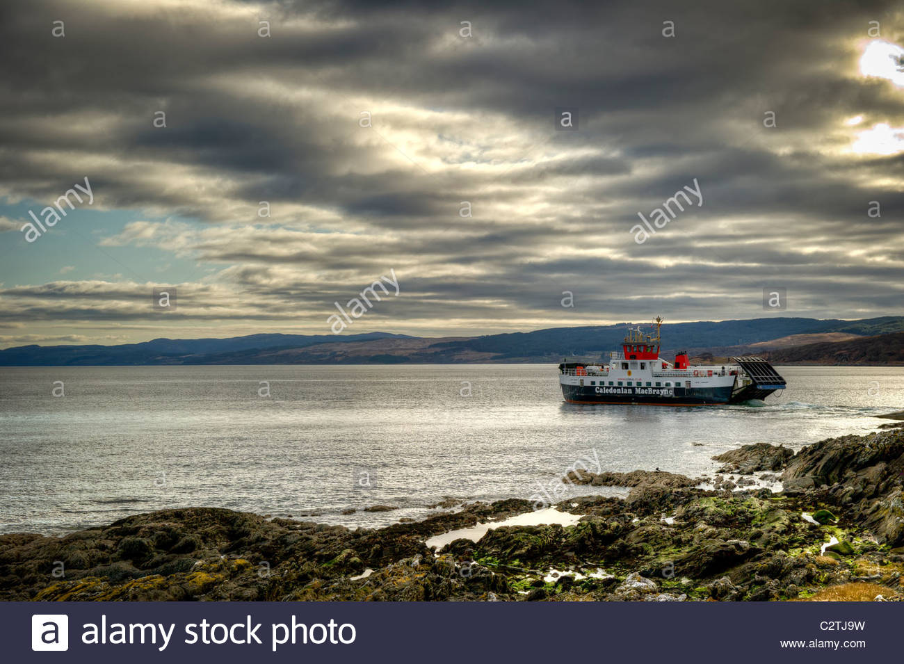 Cal Mac Ferry leaving  from Claonaig on Kintyre to go back over to Lochranza on  Arran. - Stock Image