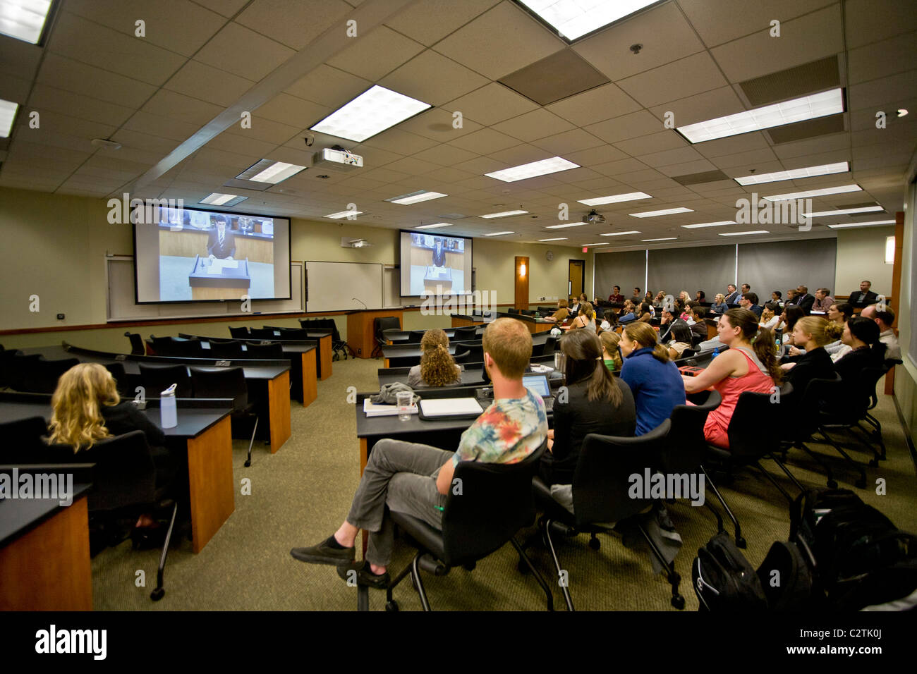 Students listen intently to video proceedings of the moot court of the law school of the University of California. - Stock Image