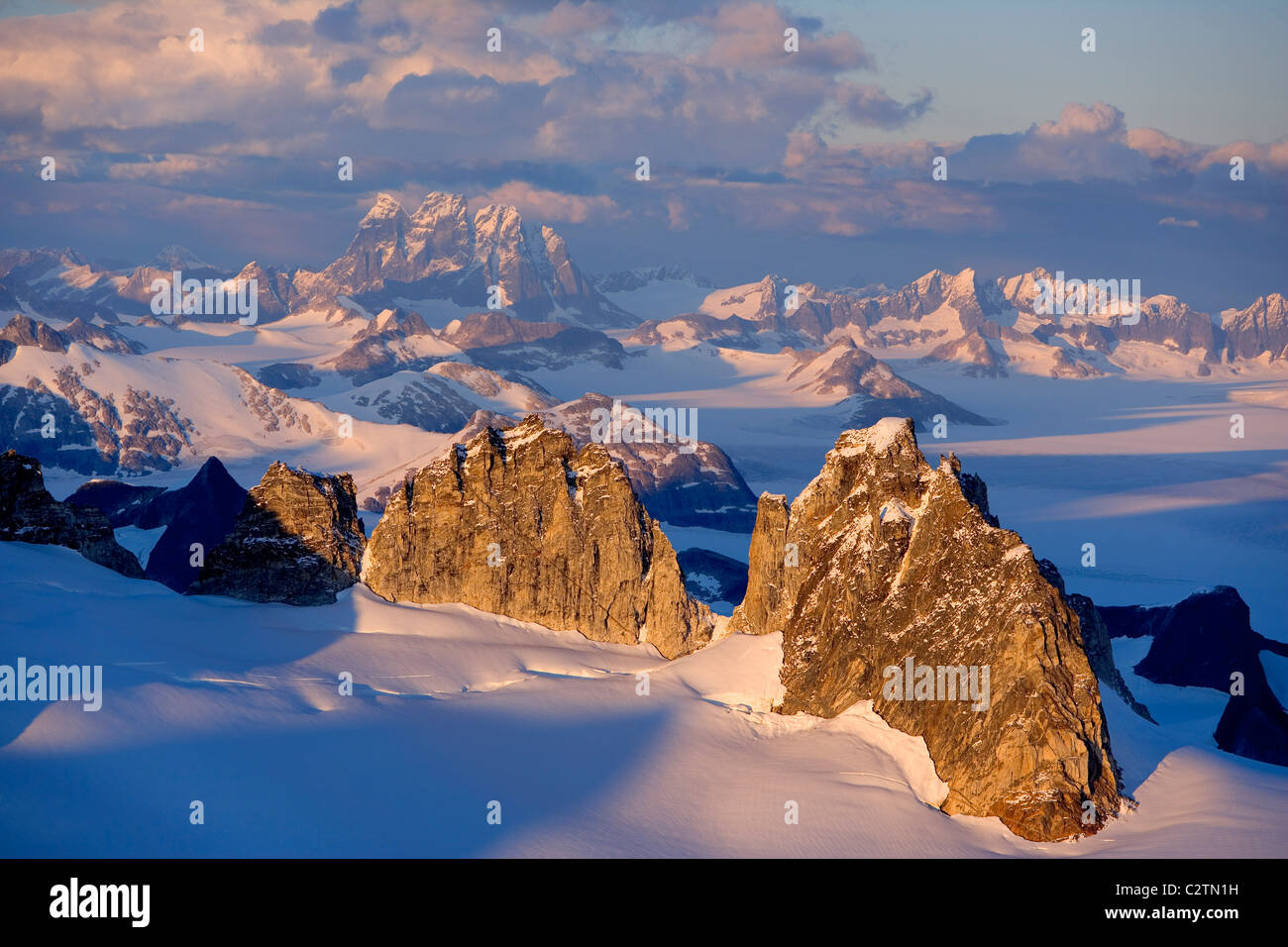 Aerial view of Juneau Ice Field bathed in evening light, looking past the Taku Range to Devil's Paw Southeast Alaska Stock Photo