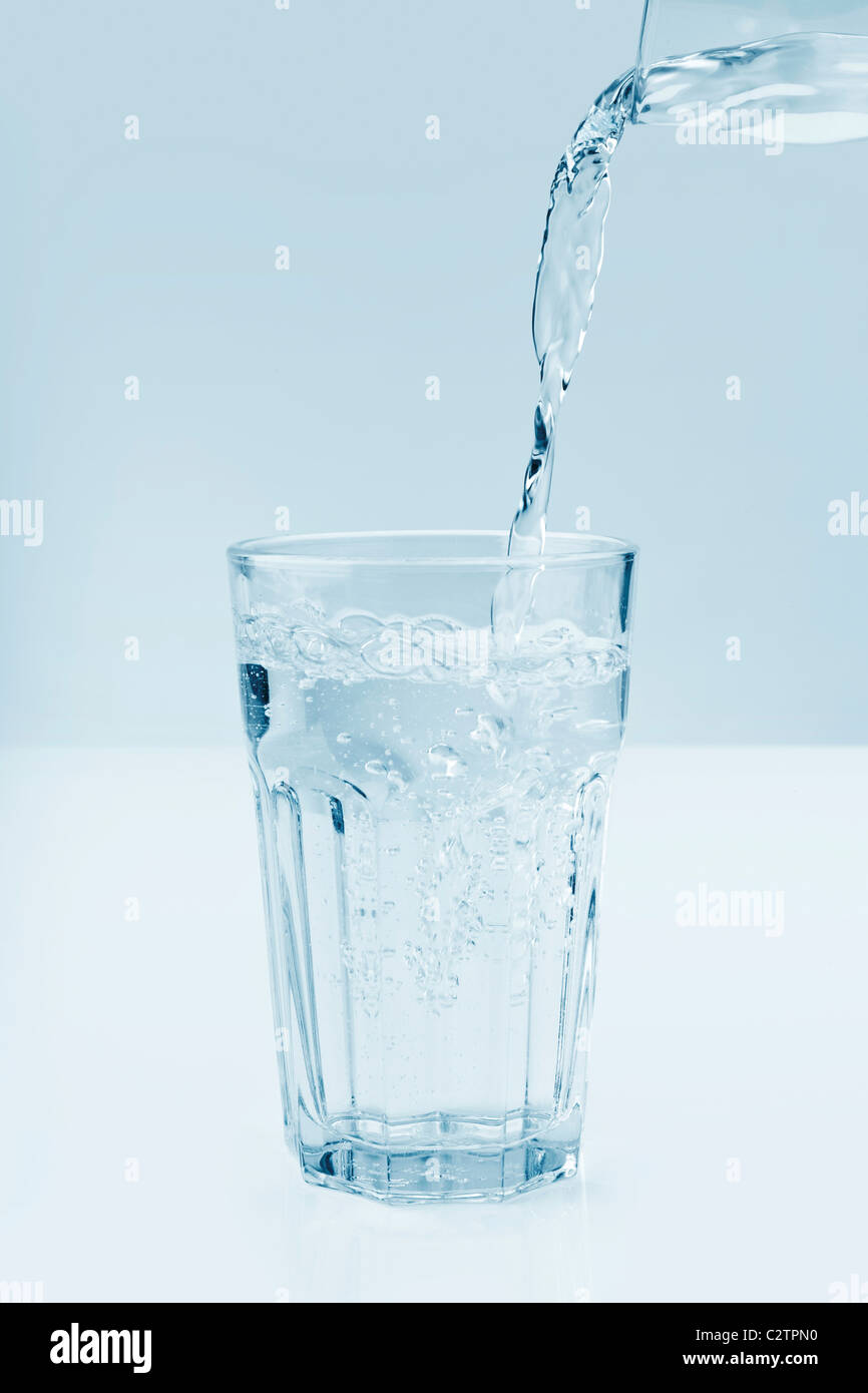 Glass of fresh water on a kitchen table - Stock Image