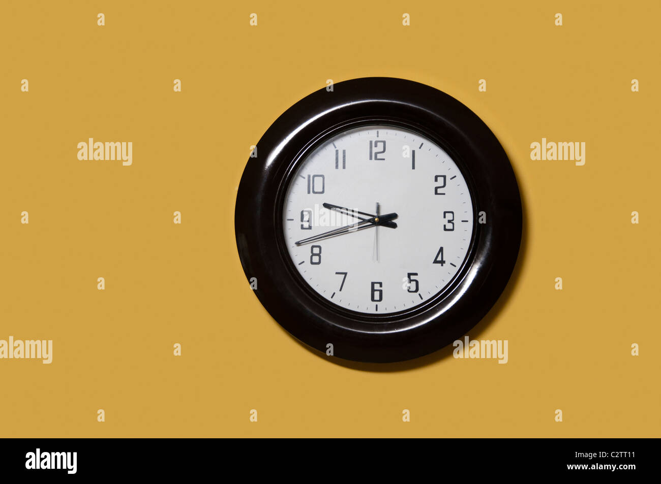 Clock on office wall - Stock Image