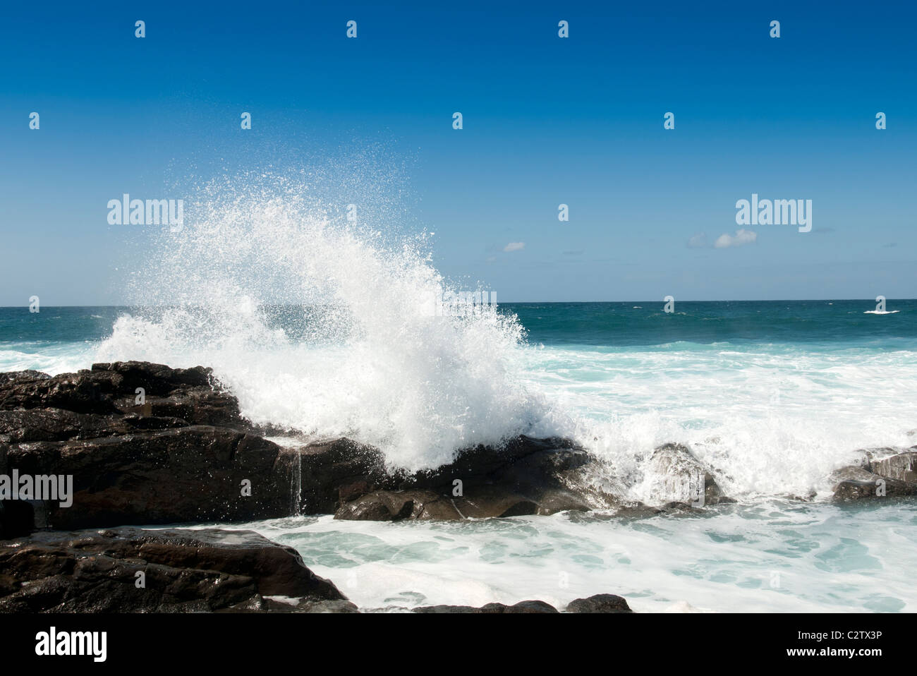 crashing waves rocks fuerteventura sea coast spray - Stock Image