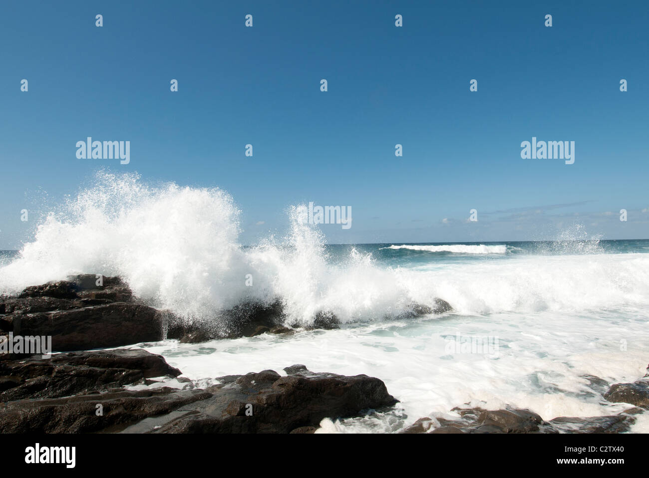 crashing waves on rocks fuerteventura canary islands - Stock Image