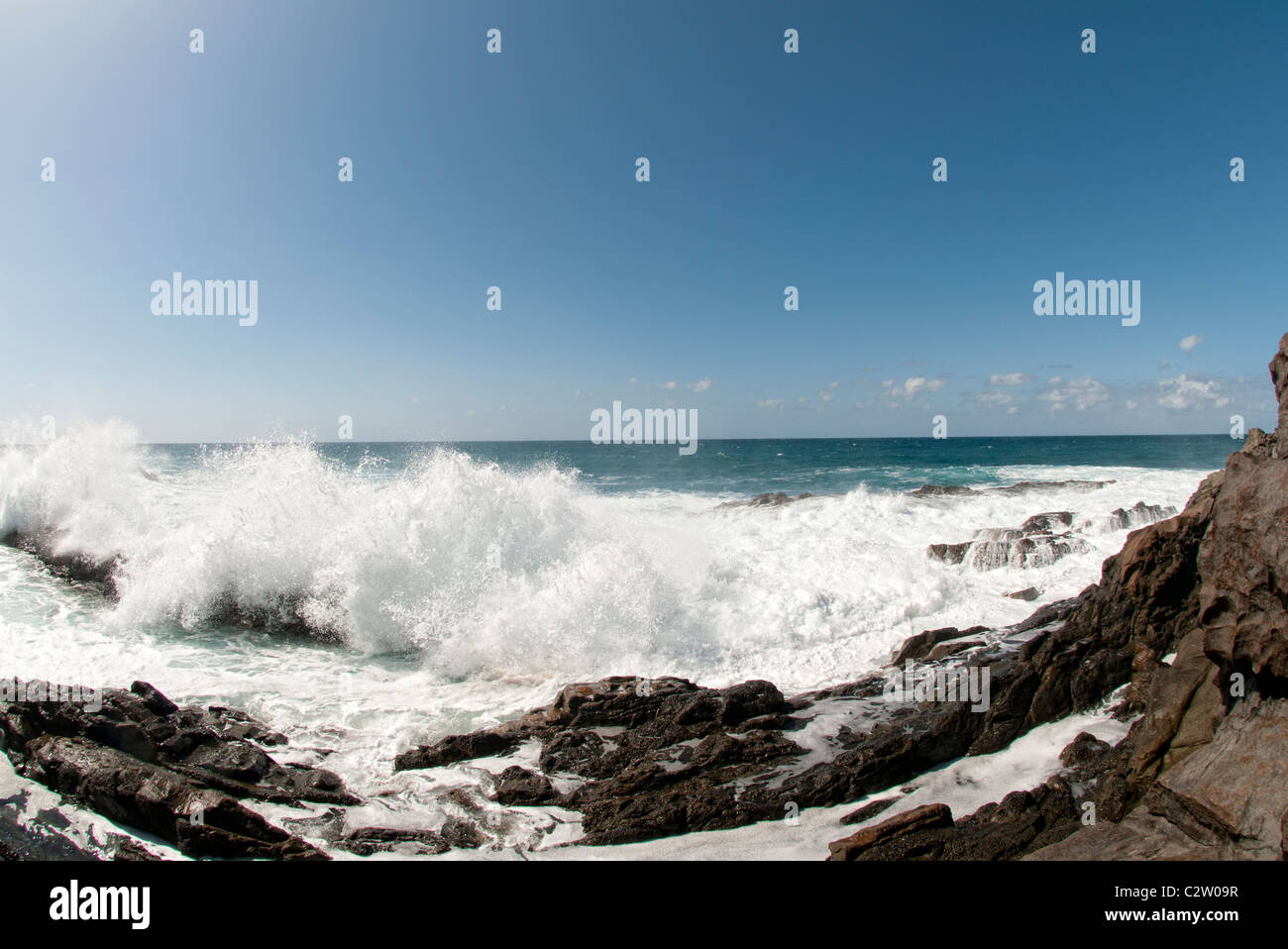 waves crashing on rocks Fuerteventura - Stock Image