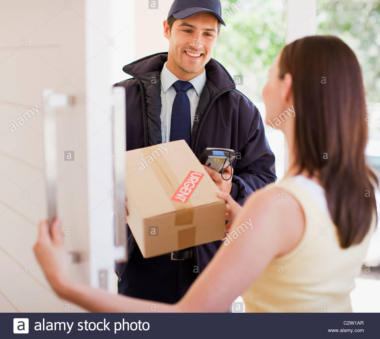delivery man handing box to woman stock photo 36199935 alamy