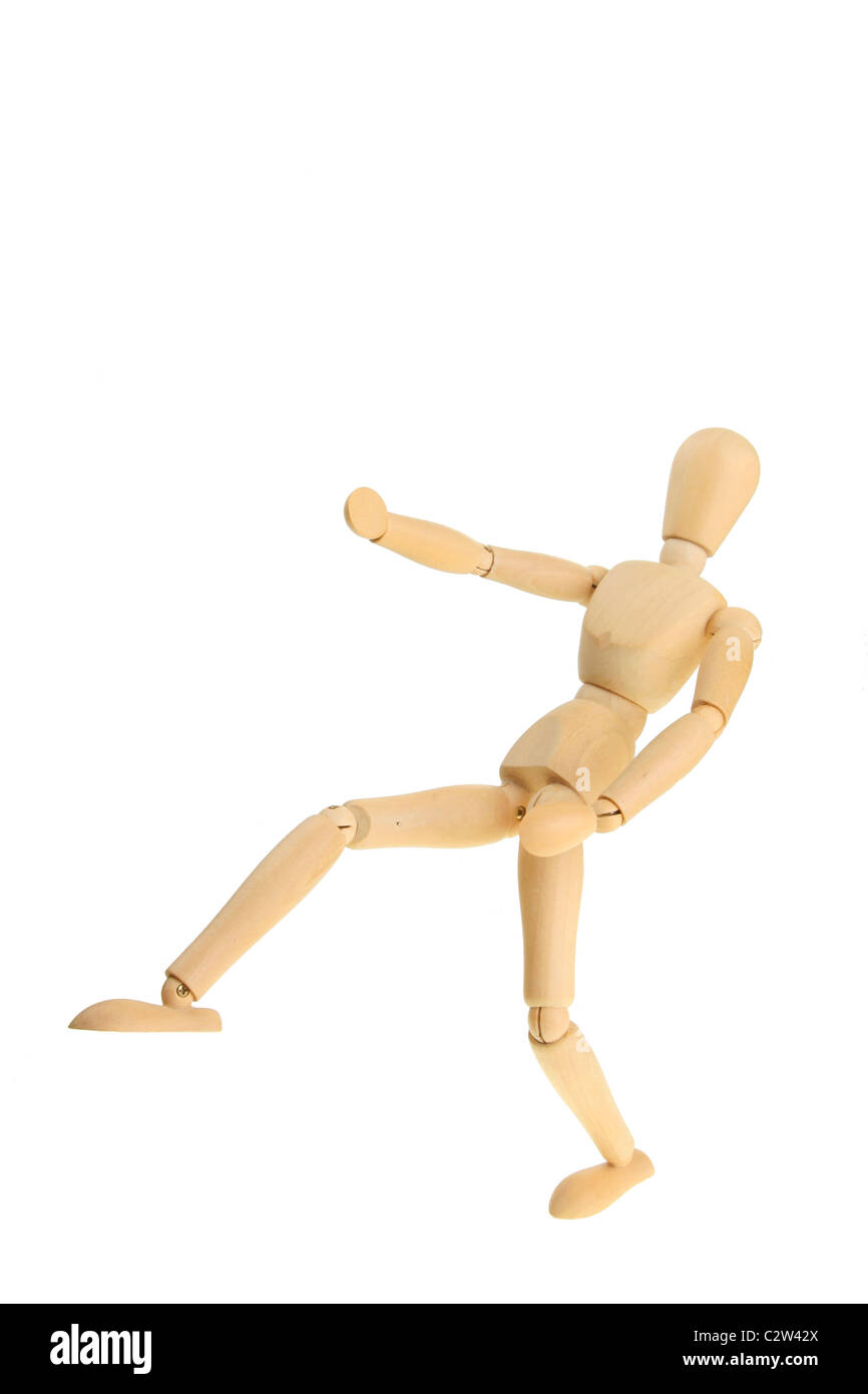 Wooden artists model in a martial arts fighting pose - Stock Image