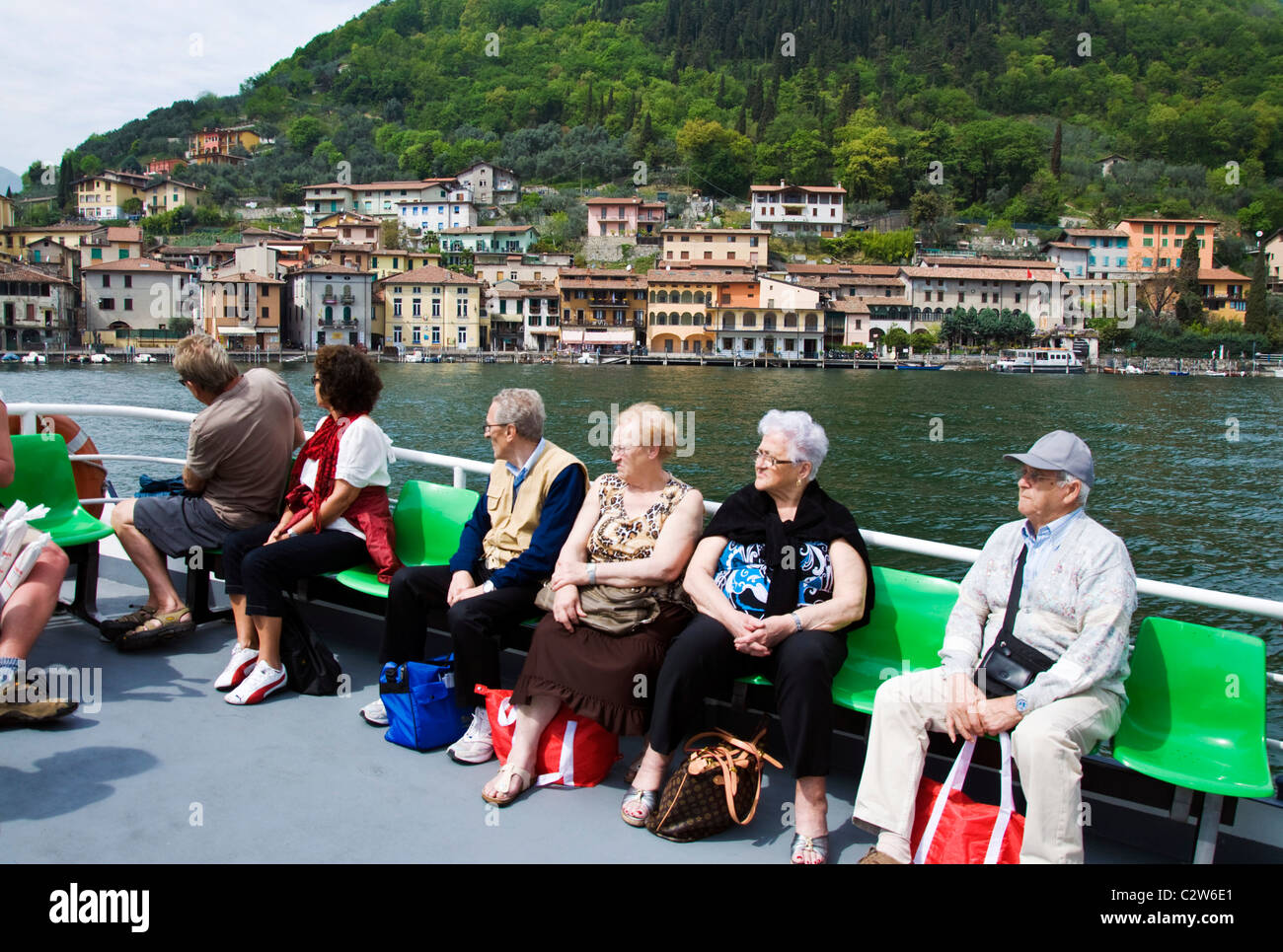 Passengers on the ferry to Monte Isola on lake Iseo - Stock Image