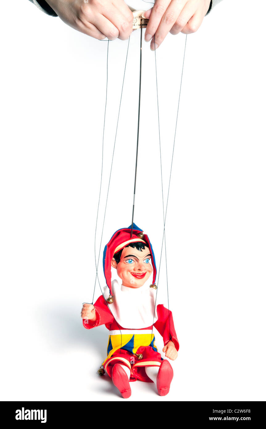 manipulator controlling a Jester marionette - Stock Image