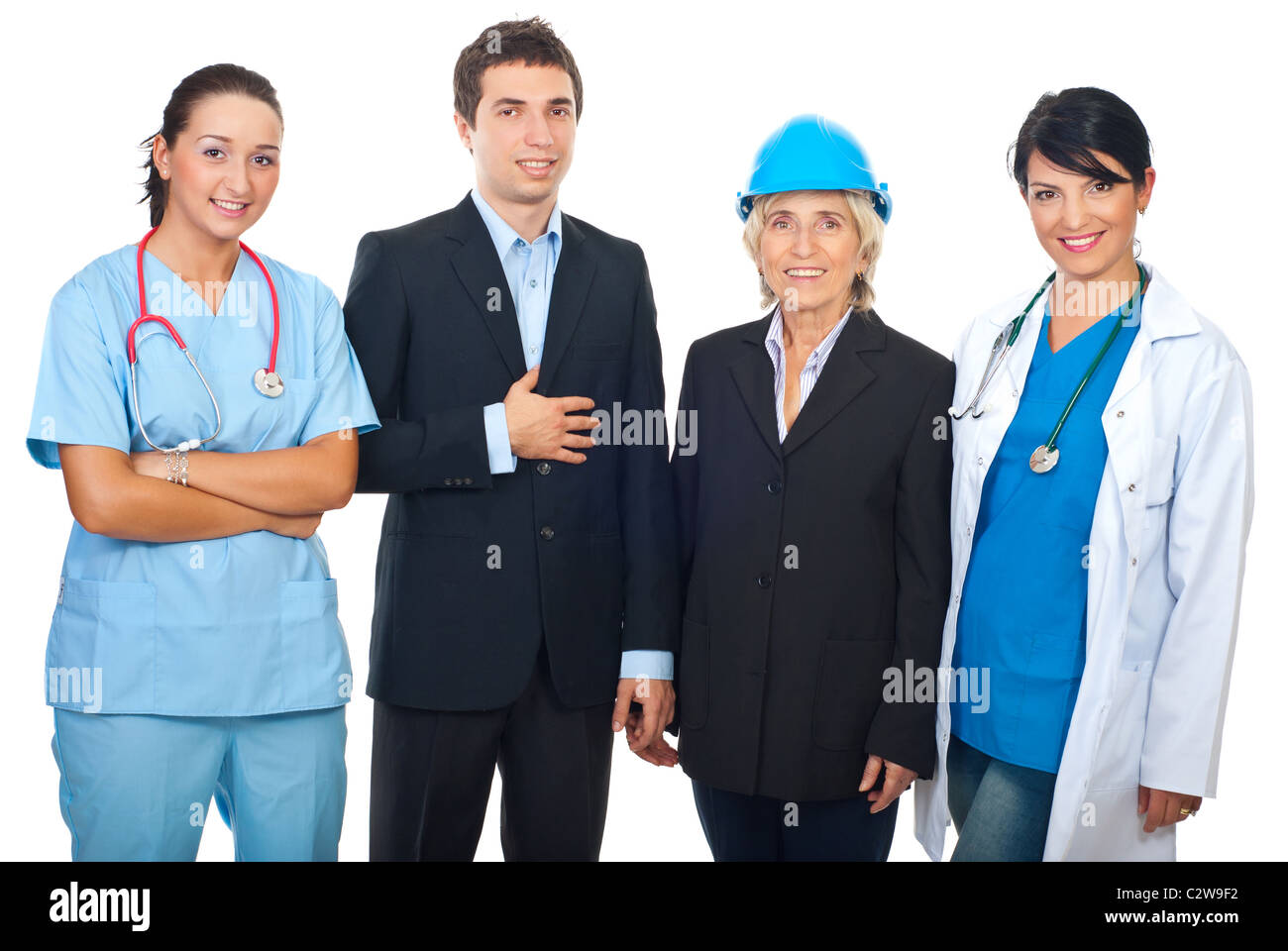 Four workers with different careers standing in a row and smiling isolated on white background - Stock Image