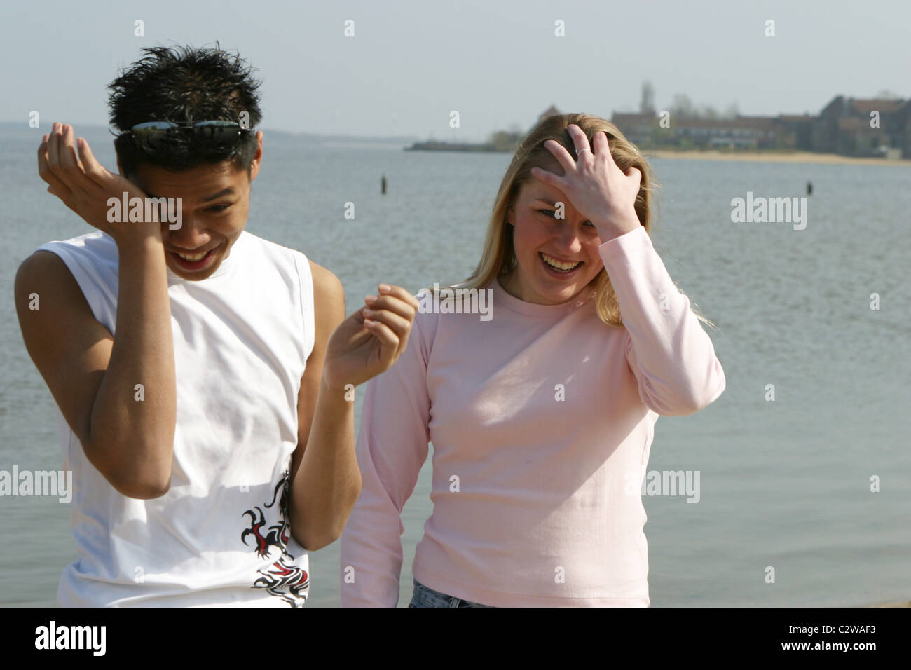 Man and woman laughing herself to tears - Stock Image