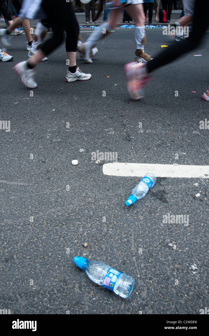 London marathon 2011 - discarded water bottles and runners feet (with motion blur) - Stock Image