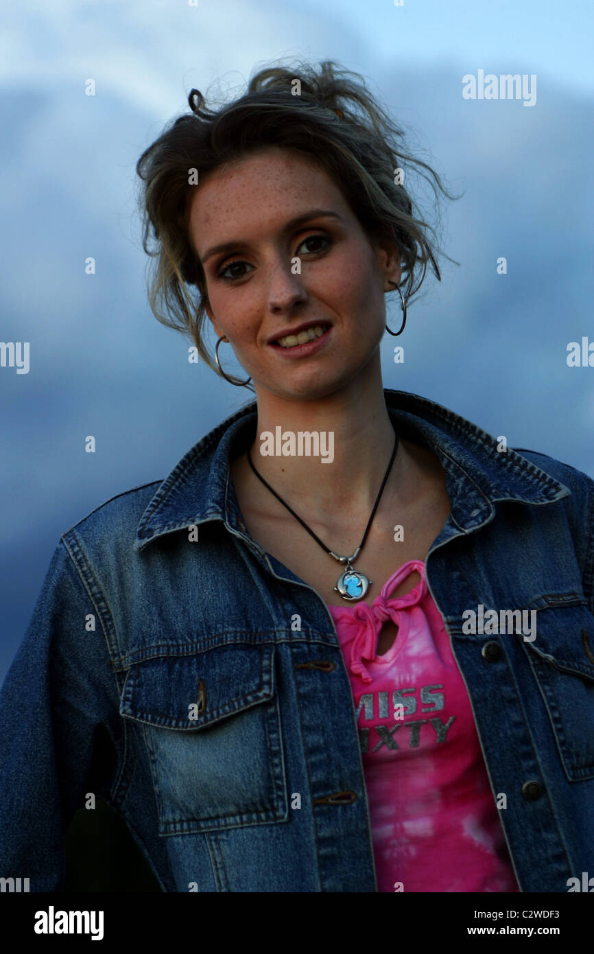 Young woman at dawn serious look at camera - Stock Image