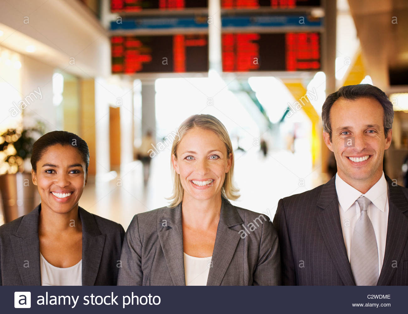 Business people standing together in airport Stock Photo