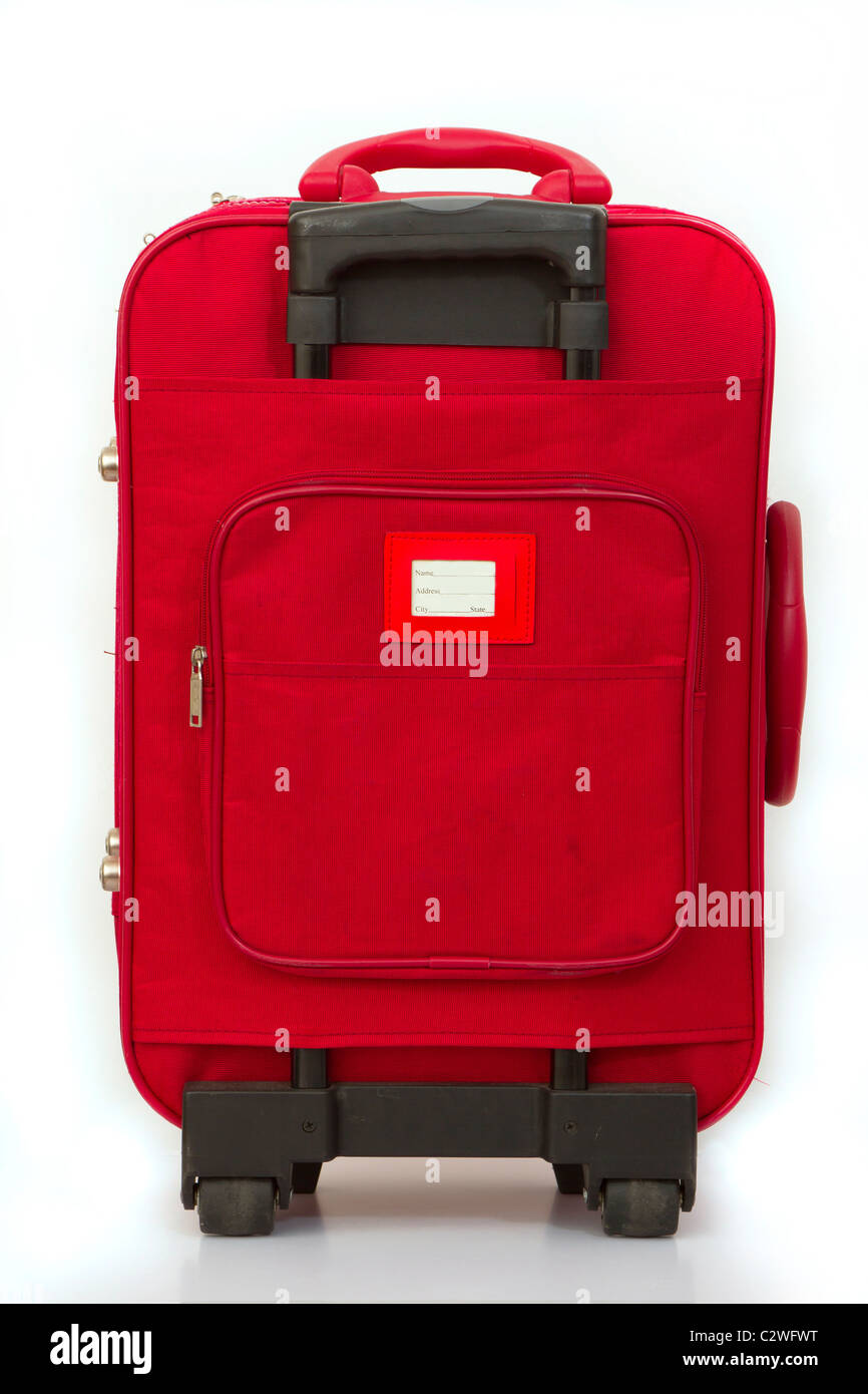 Red luggage isolated on white with tag - Stock Image