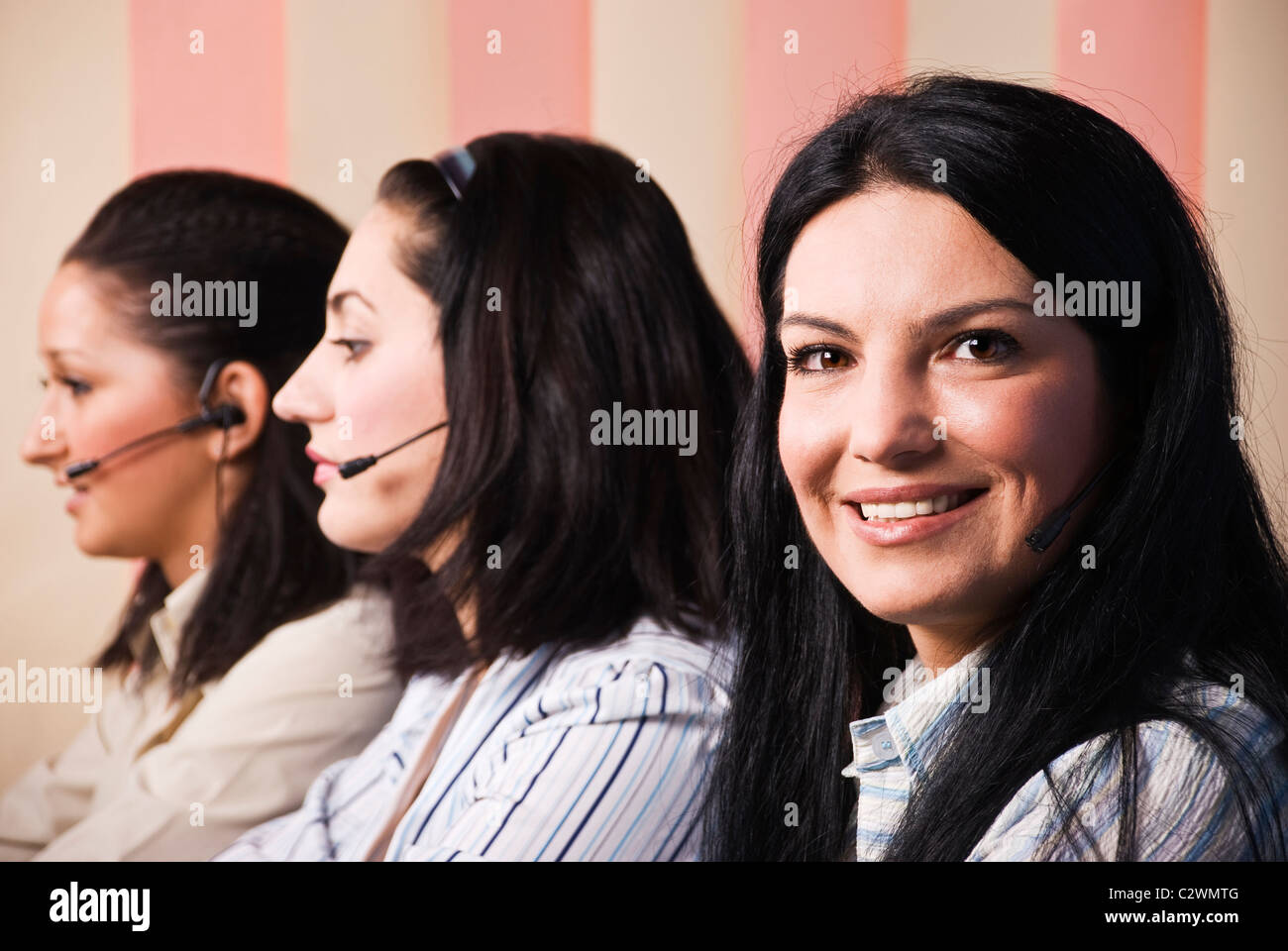 Happy three customer service women working in office and giving information Stock Photo