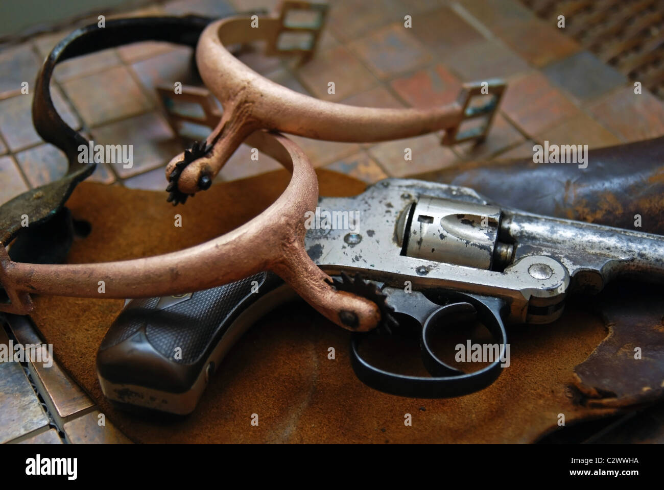 Old gun, holster, and spurs from times past. - Stock Image