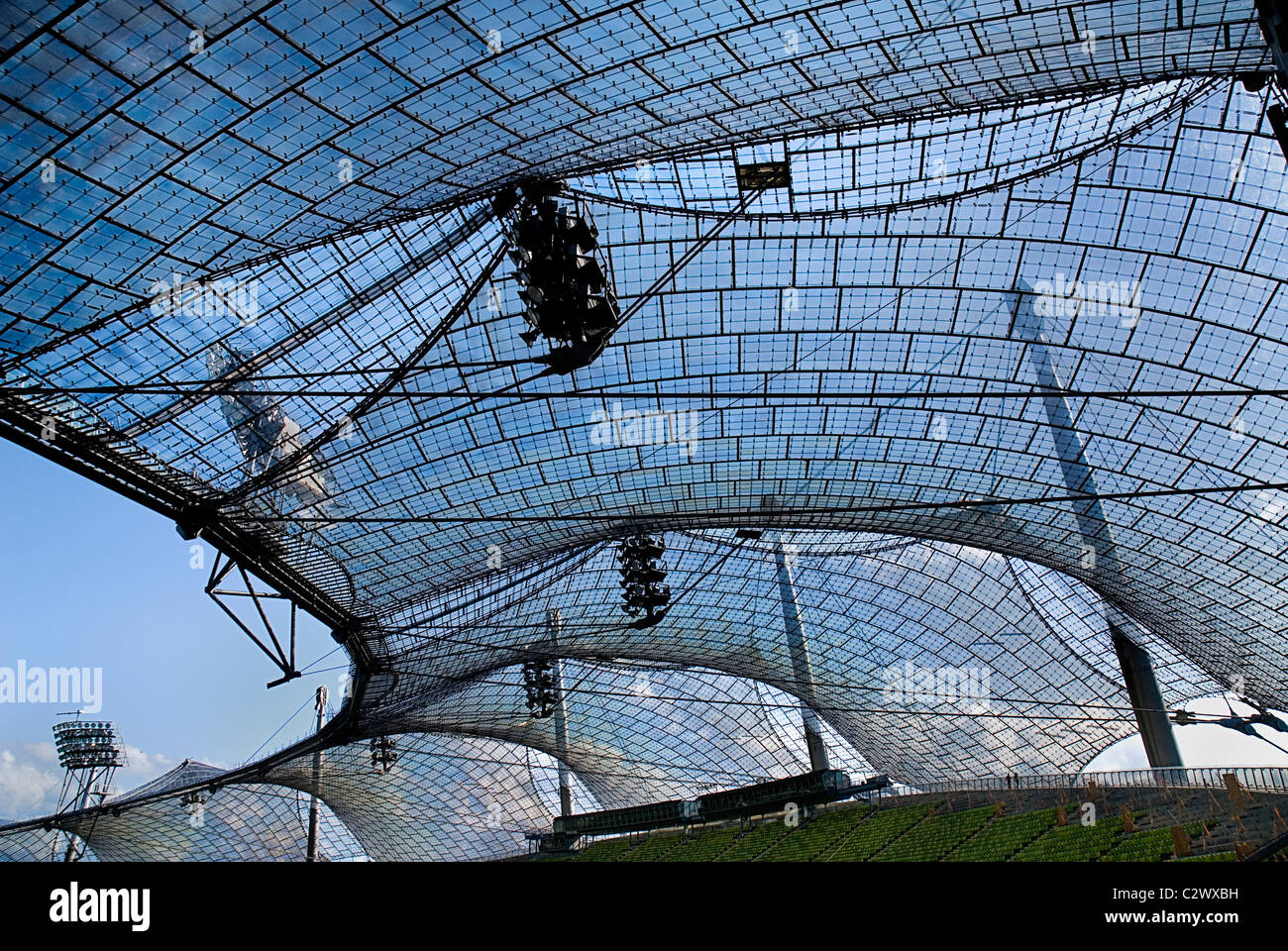 Germany Bavaria Munich 1972 Olympic Stadium curved section of bright green seating under canopy roof of acrylic Stock Photo
