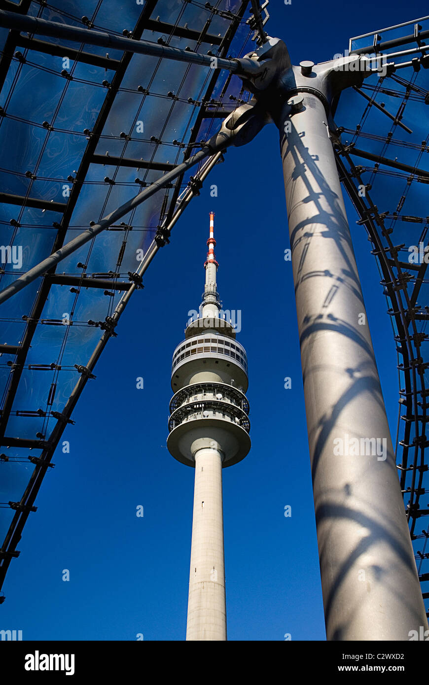 Germany Bavaria Munich 1972 Olympic Stadium section of acrylic glass canopy roof and Olympic Tower. - Stock Image