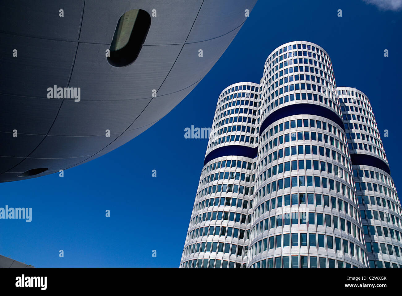 Germany, Bavaria, Munich, BMW Headquarters, The BMW Tower is 101 metres tall and mimics the shape of tyres. - Stock Image