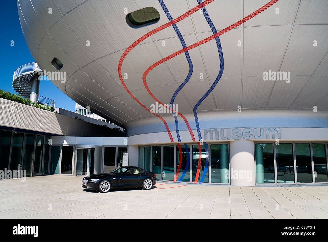 Germany, Bavaria, Munich, BMW Headquarters, The BMW Museum, Entrance with car outside. - Stock Image