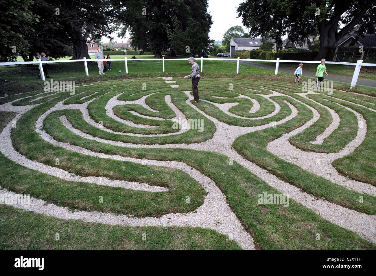 A turf labyrinth in the village of Wing, Leicestershire. - Stock Image