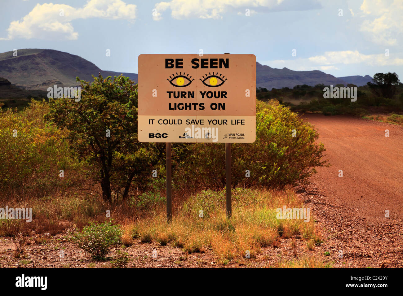 Turn your lights on road warning sign, Pilbara, Northwest Australia - Stock Image