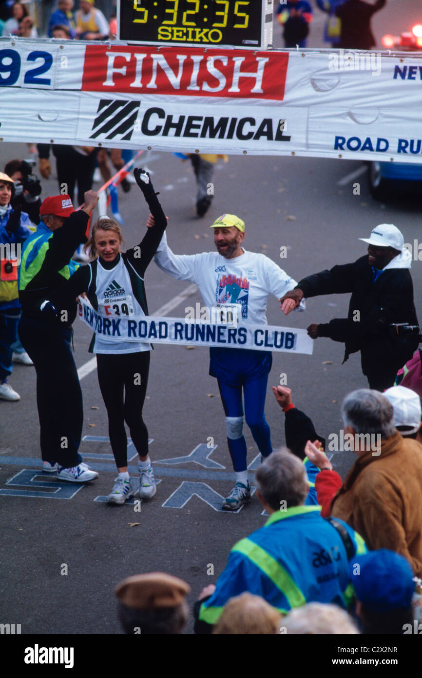 Fred Lebow with Grete Waitz after completing together the 1992 NYC Marathon. - Stock Image
