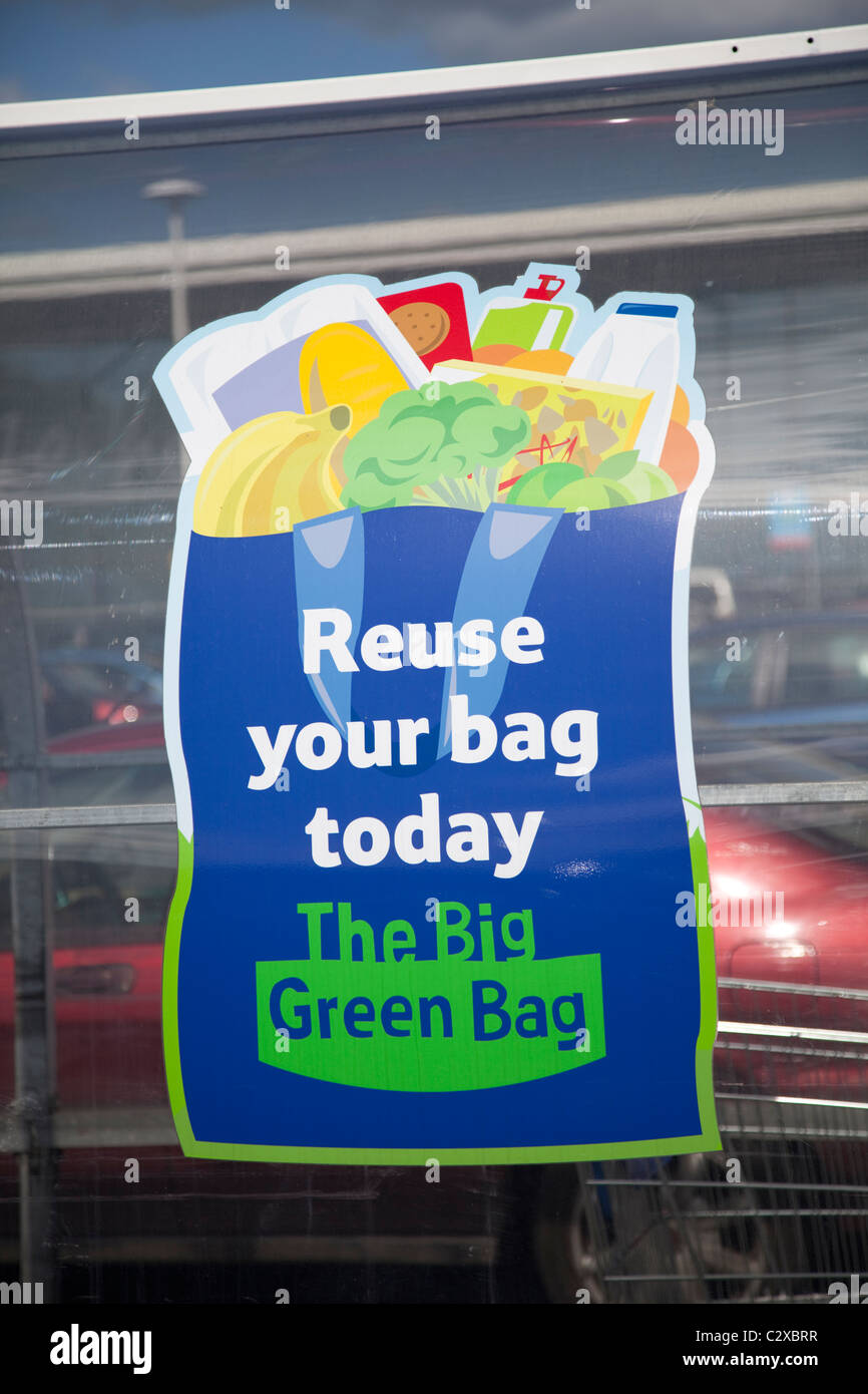 Sign encouraging use of reusable bags Tesco Evesham UK - Stock Image