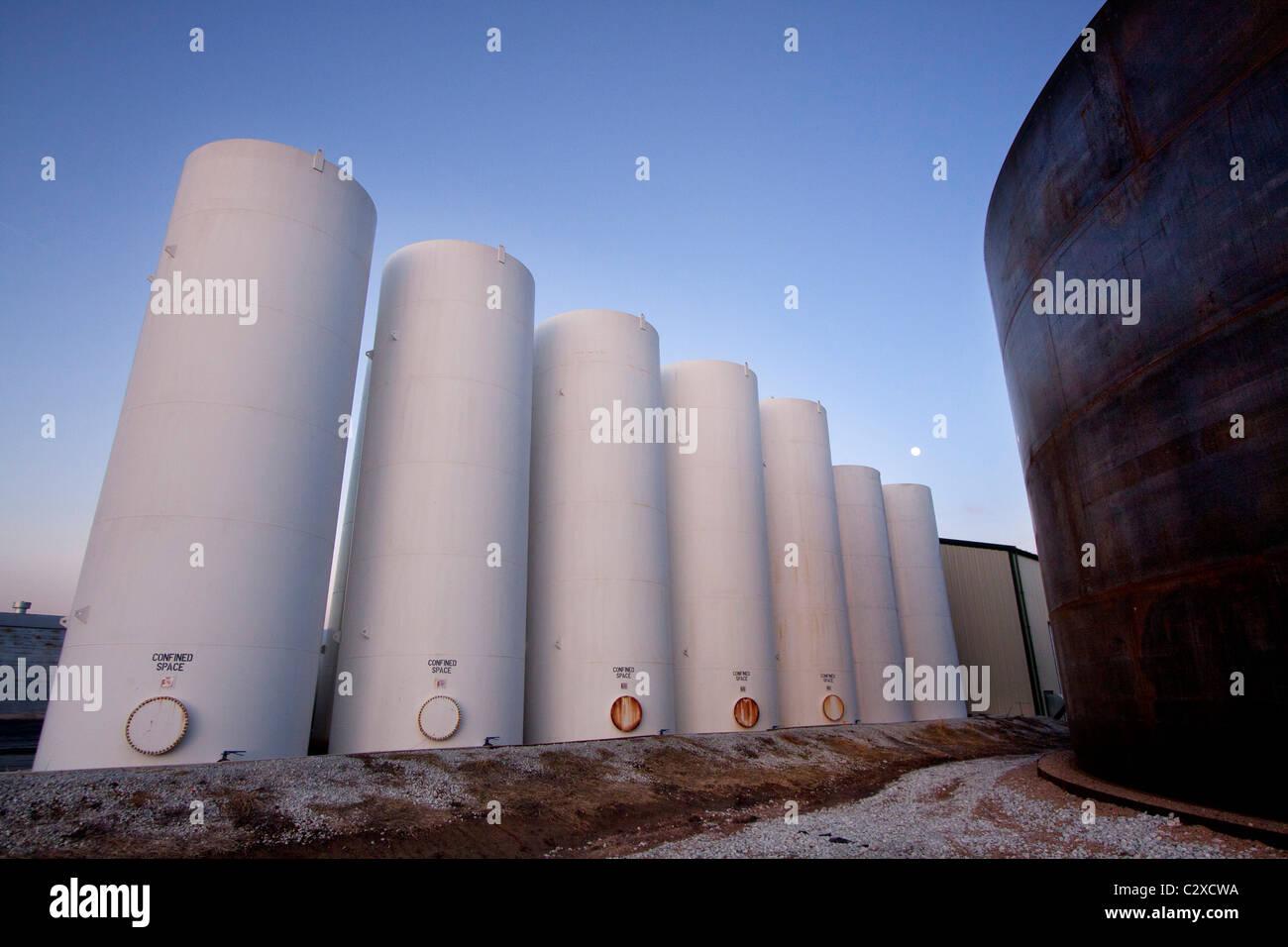 Moon framed by agricultural tanks in rural Nebraska, 2/16/2011 - Stock Image