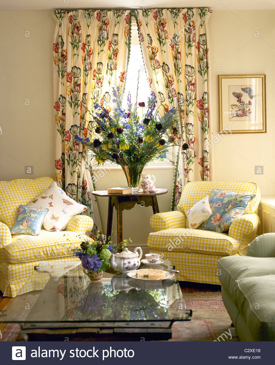 Traditional Country Style Sitting Room With Floral Curtains Stock